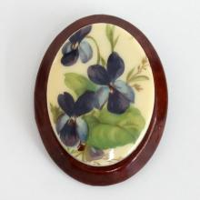 Oval shape wooden plate with picture of flowers on white acrylic on top brooch pin