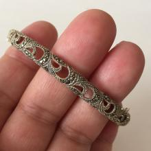 Sterling silver black antique finish bangle bracelet with hidden clasp, extra safety chain and marcasites all around