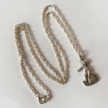 M.I.HUMMEL CLUB, GOEBEL, 1990: Vintage sterling silver twisted chain and BOY WITH UMBRELLA AND BAG shaped pendant, signed