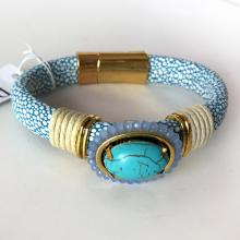 LAURA JANELLE: Gold tone signed clasp, prongs set oval turquoise color cabochon leather strap bracelet
