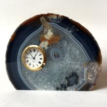 AGATE CLOCK. Round gold plated quartz watch with Japan movement mounted in slice of blue lace agate slab