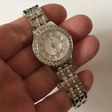 Silver tone round ladies VALLETTA watch with rhinestones on dial, bezel and on matching panther style bracelet