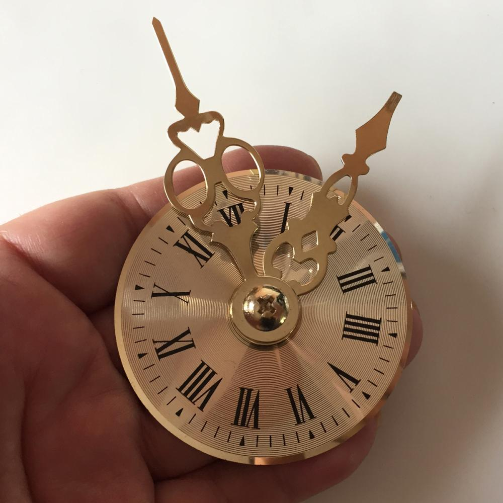 Gold tone watch Dial shape brooch with oversized Hands