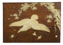A Japanese wood and ivory inlaid rectangular panel
