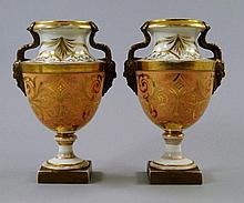 A pair of English porcelain mask handled classical