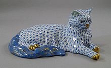 A Herend model of a cat, painted and gilded,