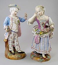 A pair of Meissen figures of a boy and girl, late