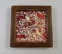 A William De Morgan tile, painted with birds, in a