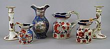 A set of three graduated ironstone jugs, 19th