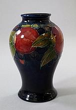 'Pomegranate', a Moorcroft baluster vase designed