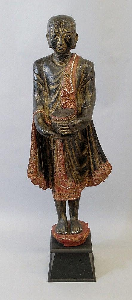 A Burmese figure of a standing monk, 19th century,