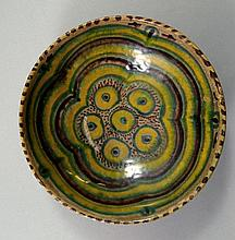 A Islamic pottery bowl, Siran 12th century, green,