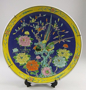 A Chinese famille jaune wall plate, 20th century,