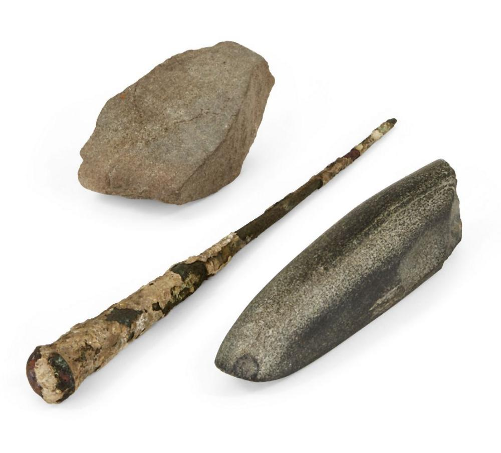 A Neolithic basalt whetstone (blade sharpener), 14.8cm; an iron nail, 26cm
