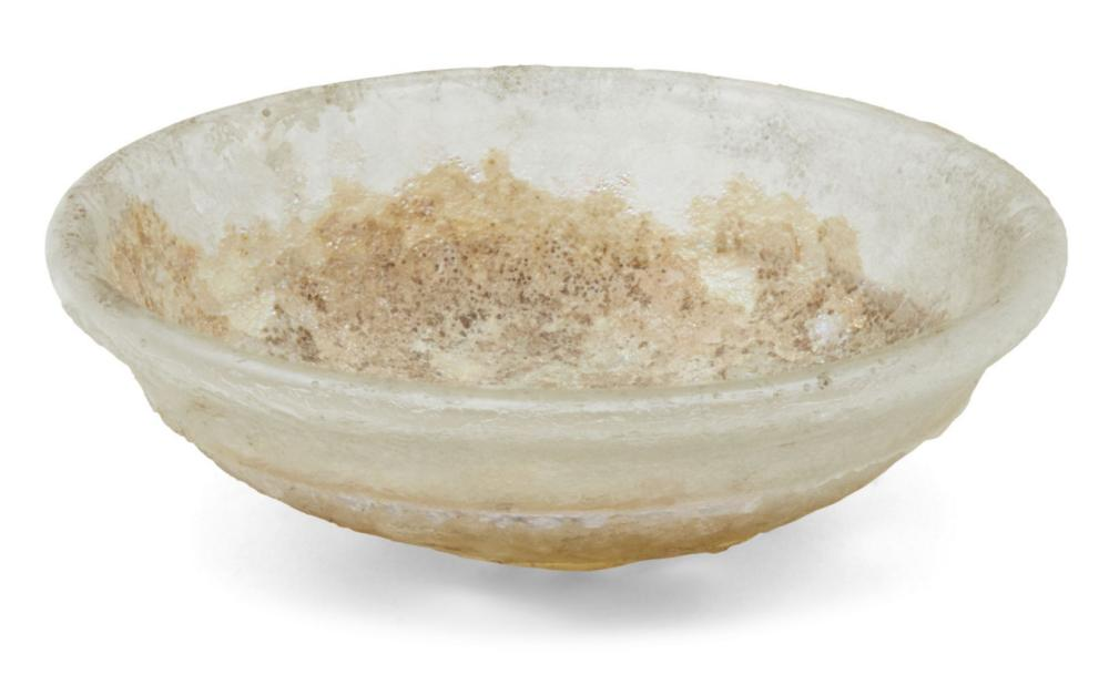 A Roman clear glass dish and a lid, 2nd-4th century AD, the first of deep f