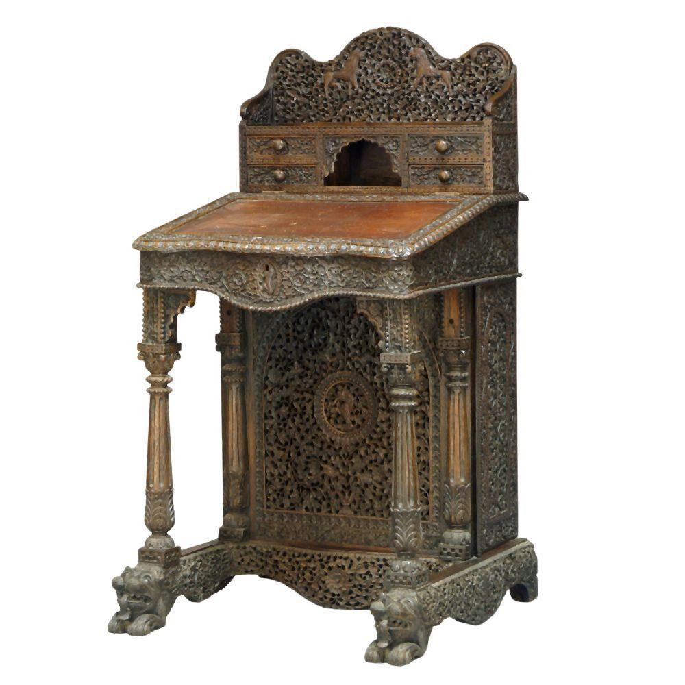An Anglo-Indian carved rosewood davenport, Bombay, India, late 19th centur