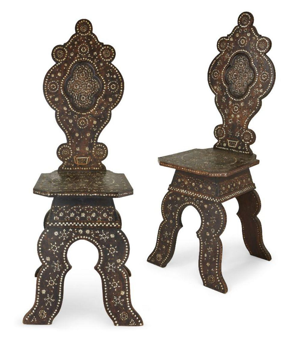 A pair of Syrian bone inlaid hall chairs, 19th century, with scalloped back