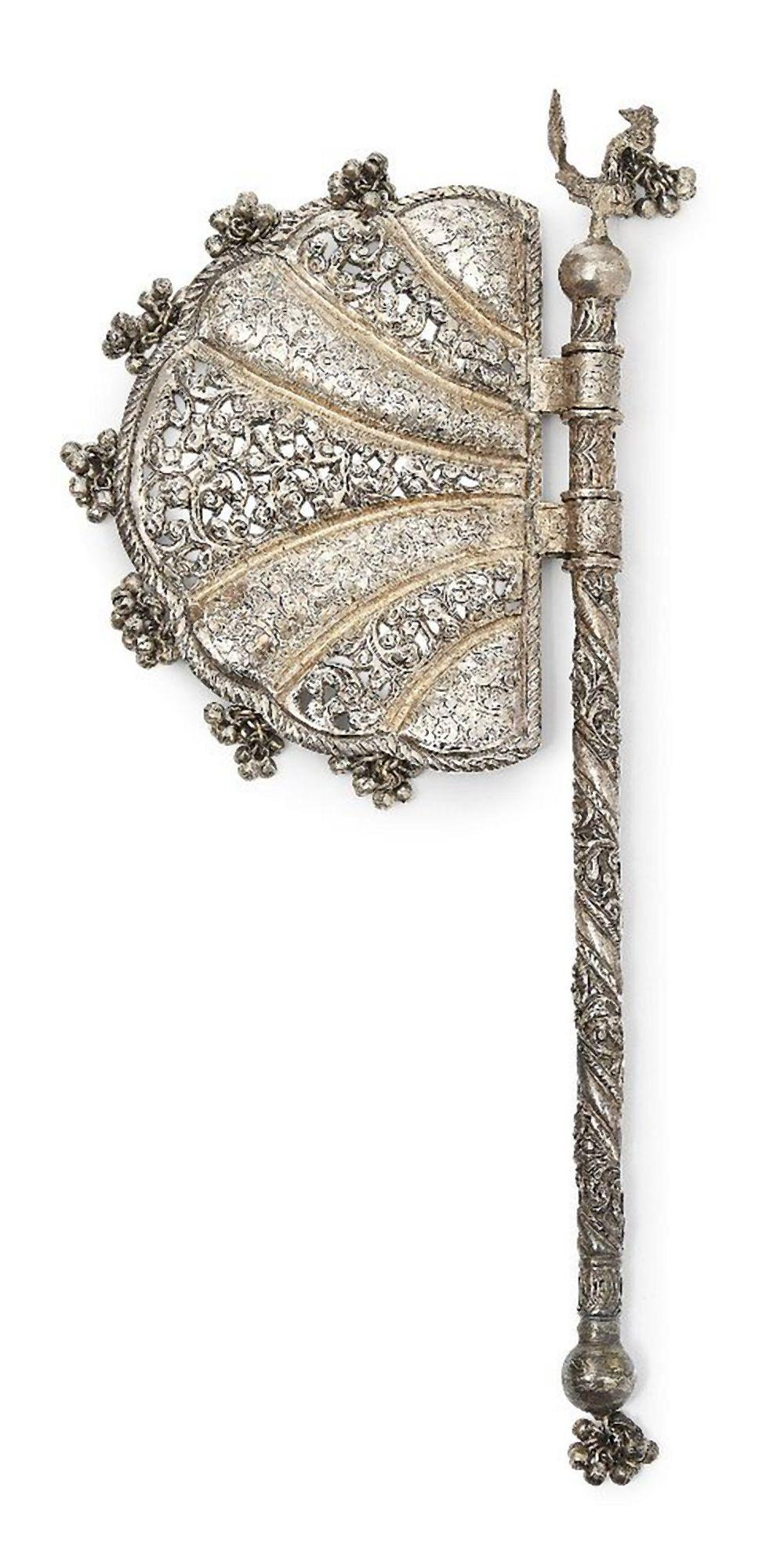 A silver ceremonial axe, India, early 20th century, the fan-shaped head for
