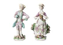 A pair of English porcelain figures of a girl and boy