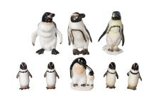 A collection of five Royal Doulton penguins