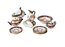 A  Royal Crown Derby miniature teapot and coverand a sugar pot and cover