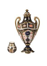 A Royal Crown Derby miniature twin handled urn and cover