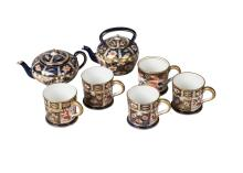 A  set of four Royal Crown Derby miniature mugs