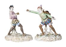 A pair of Continental porcelain figures of two fencing gentlemen