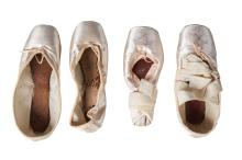A pair of satin ballet shoes signed by Darcey Bussell