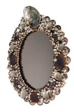 An oval  shell encrusted  mirror by Anthony Redmile