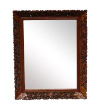 An English carved fruitwood mirror frame