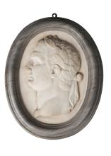 An Italian Carrara marble oval portrait relief of a Roman emperor