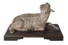 A Continental painted terracotta model of a lamb