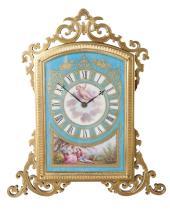 A Victorian gilt brass and Sevres style porcelain strut clock