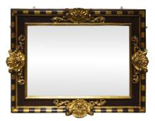 A Spanish ebonised and parcel gilt wall mirror