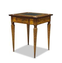 A Continental walnut and floral marquetry inlaid games table