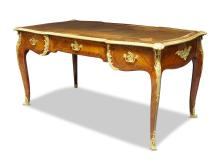 A Louis XV style gilt metal mounted kingwood and cross banded serpentine bureau plat