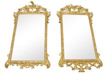 A pair of George II style gilt wood mirrors