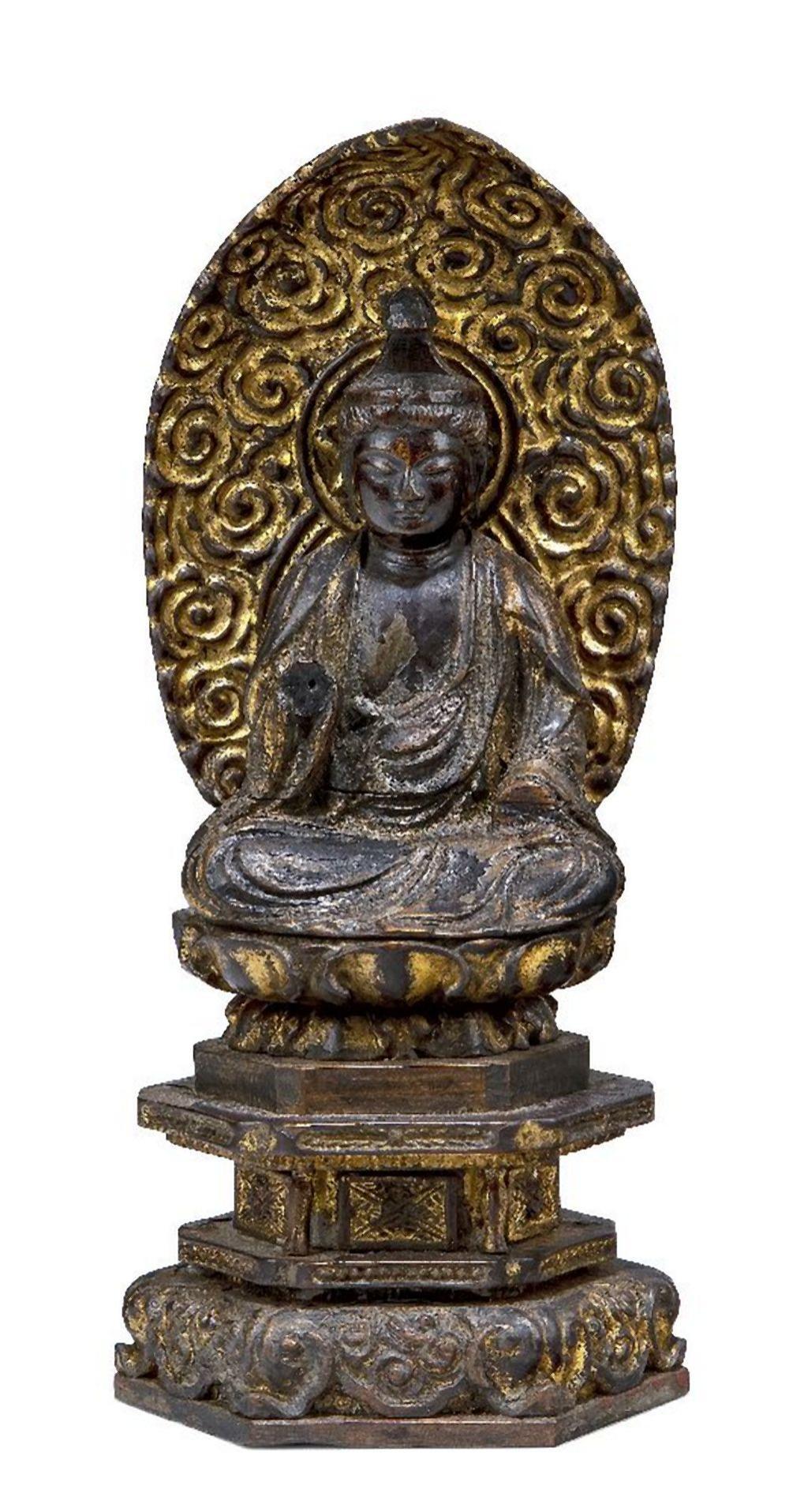 A Japanese parcel-gilt carving of Amitabha Buddha, 18th century, carved seated on a hexagonal base,