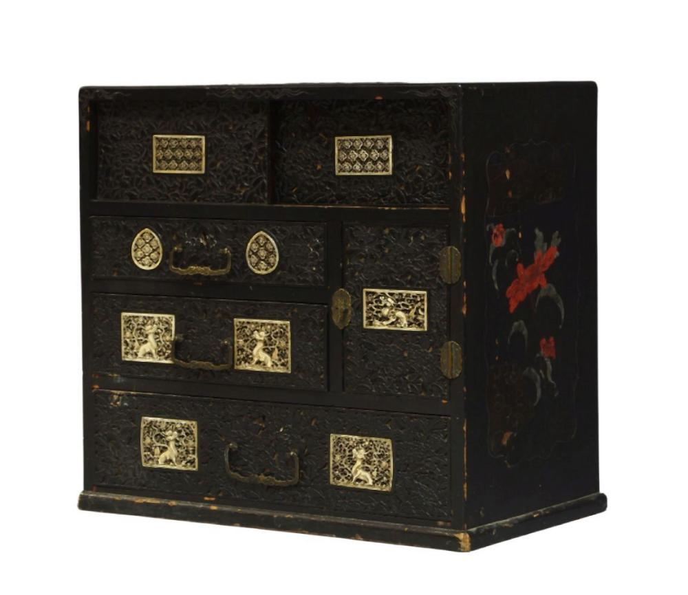 A Japanese black lacquer table top cabinet, mid-19th century, with two sliding doors above three dra