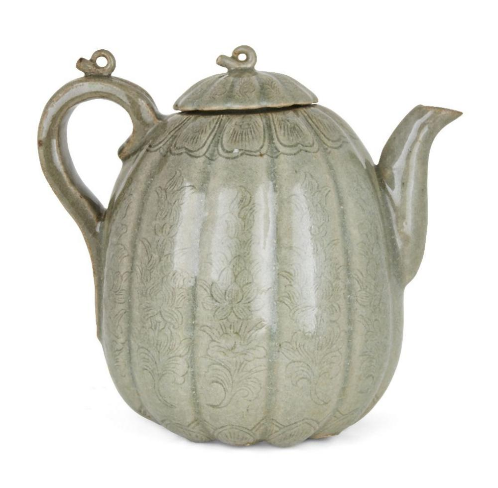 A Korean stoneware celadon melon-shaped teapot, Goryeo dynasty, the lobed body decorated with incise