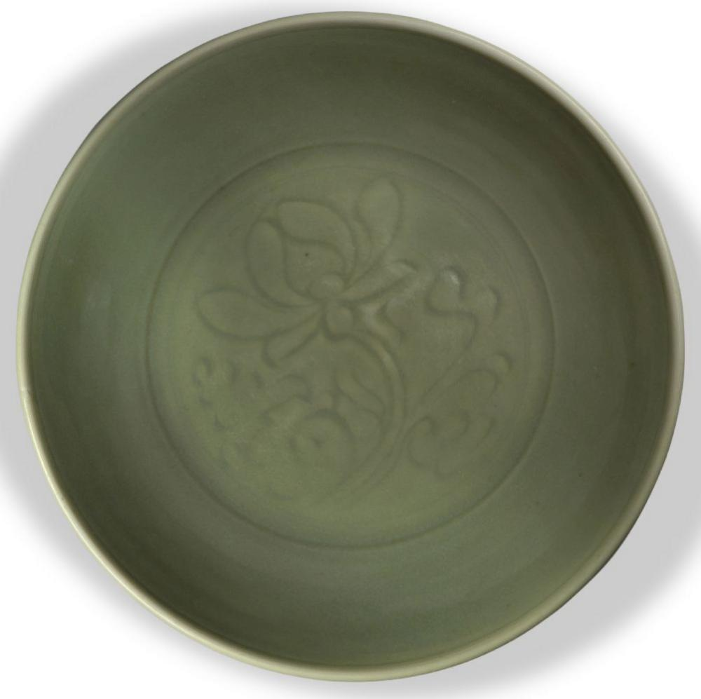 A Chinese Longquan celadon 'lotus' charger, Ming dynasty, the interior decorated with a large incise