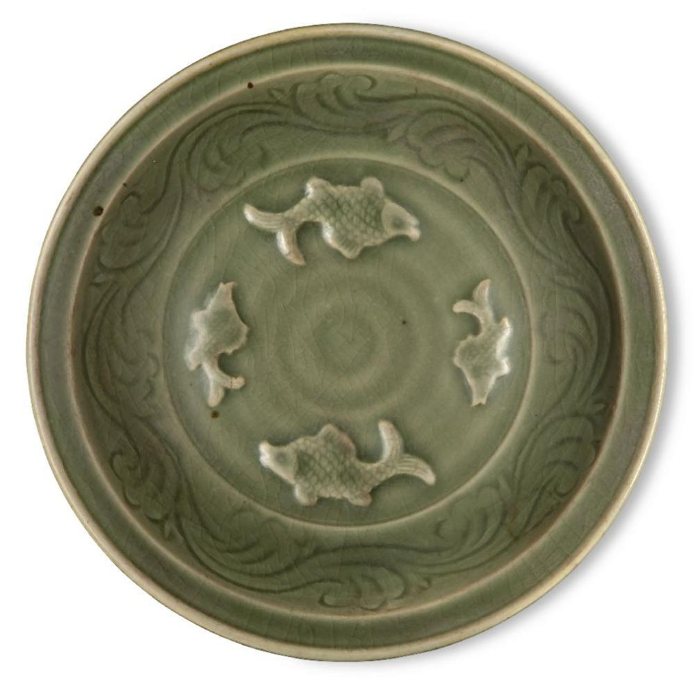 A Chinese Longquan celadon 'fish' dish, Ming dynasty, the interior decorated with four moulded fish