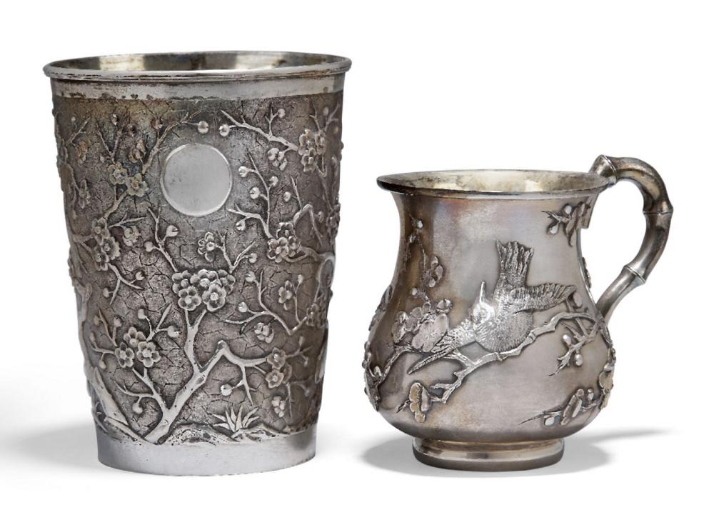 A Chinese export silver beaker, early 20th century, repousse-decorated with prunus blossom on a text