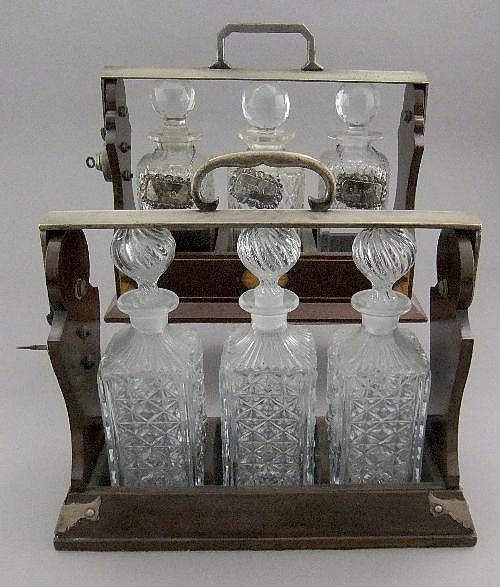 Two Edwardian triple decanter tantalus, early 20th