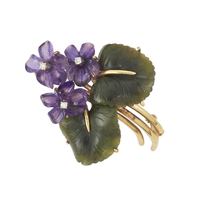 An amethyst, and jade flower spray brooch, designed as three carved amethyst flowerheads each with single-cut diamond single stone stamen and two carved nephrite jade leaves to a triple stem, 5cm long