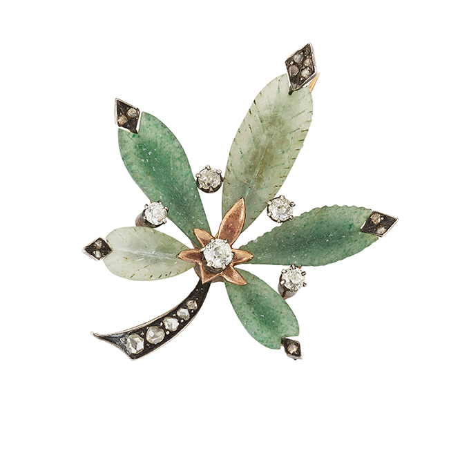 A French, quartz and diamond Maple leaf brooch, designed with five carved green dyed quartz leave with rose-cut diamond set tips, central circular-cut diamond stamen, five diamond single stone points and rose-cut diamond graduated stem, circa 1900, French guarantee mark, 4.5cm long