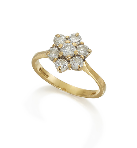 A diamond seven stone cluster ring, mounted in 18ct gold, hallmarks for London 1990, size L