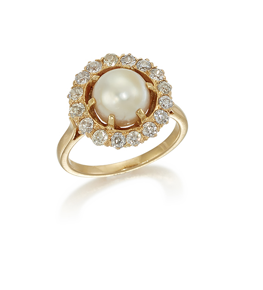 A pearl and diamond ring, the single pearl with a border of brilliant cut diamonds, size N (Please note the pearl has not been tested for natural origin)