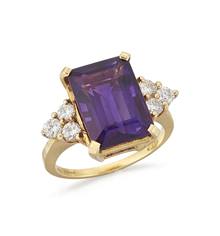 An 18ct. gold, amethyst and diamond ring, the rectangular-cut cornered amethyst in claw-set mount to circular-cut diamond three stone shoulders, ring size N